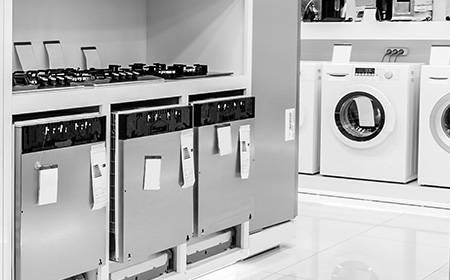 photo of a row of appliances in a retail store